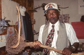 Osker Gilchrist and some of the healing paraphernalia in his treatment room