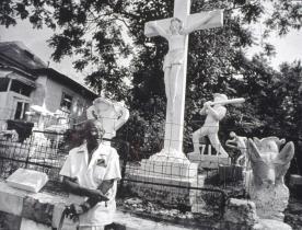 Eldren M. Bailey in front of his sculpture garden