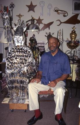 Sandy Hall in his apartment with his Statue of Liberty