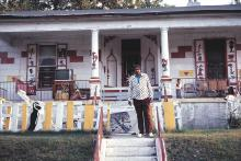 Joe Light in front of his house