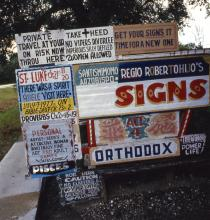 Signs in Royal Robertson's yard